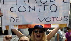 "Opposition supporters in Caracas, Venezuela, on April 15 protest the official results of the Venezuelan presidential election with a sign in Spanish that reads ""fraudulent counting of votes."" Hugo Chavez's hand-picked successor, Nicolas Maduro, won a razor-thin victory in Sunday's special presidential election but the opposition candidate Henrique Capriles refused to accept the result and demanded a full recount. (AP Photo/Fernando Llano)"