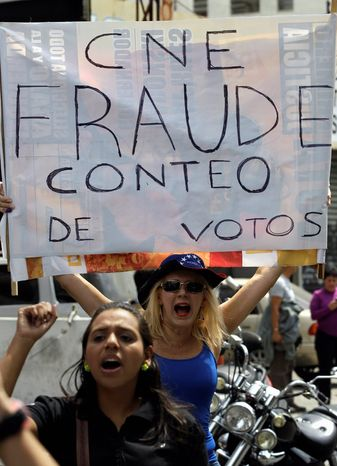 "Opposition supporters in Caracas, Venezuela, on April 15 protest the official results of the Venezuelan presidential election with a sign in Spanish that reads ""fraudulent counting of votes."" Hugo Chavez's hand-picked successor, Nicolas Maduro, w"