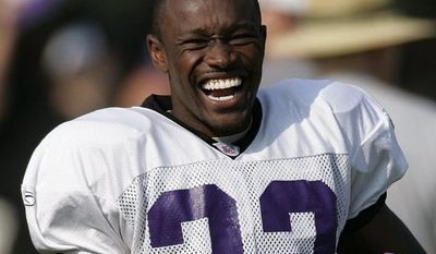 **FILE** Baltimore Ravens cornerback Samari Rolle laughs during a drill at the Ravens football training camp in Westminster, Md., Tuesday, Aug. 8, 2006.(AP Photo/Chris Gardner)