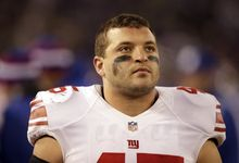 New York Giants fullback Henry Hynoski looks on from the sideline during an NFL football game against the Baltimore Ravens in Baltimore, Sunday, Dec. 23, 2012. (AP Photo/Evan Vucci)