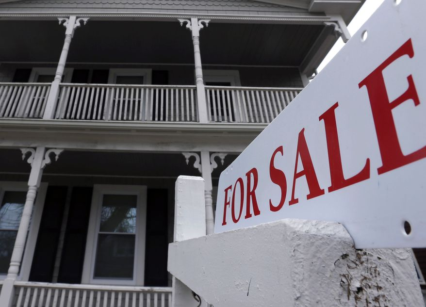 "A ""for sale"" sign hangs in front of a house in Plymouth, Mass., on Tuesday, March 5, 2013. Sales of previously occupied homes dipped in March as the supply remained tight. (AP Photo/Steven Senne)"