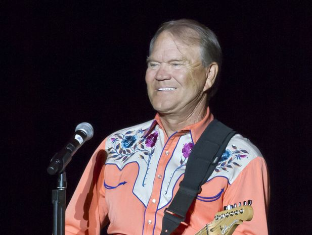 Singer Glen Campbell performs during his Goodbye Tour in Little Rock, Ark., on Sept. 6, 2012. (AP Photo/D
