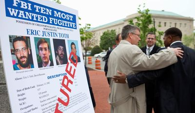 Ronald Hosko, of the FBI's Criminal Investigative Division (left), and Vince Cohen Jr., assistant U.S. attorney for the District, congratulate each other after Tuesday's news conference announcing the apprehension of Eric Justin Toth, who was among the FBI's Ten Most Wanted Fugitives as a suspect in a child pornography investigation.
