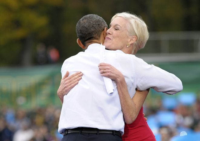 **FILE** President Obama hugs Cecile Richards, president of the Planned Parenthood Action Fund, after she introduced the president at a campaign event where he spoke about choice facing women in the election rally at George Mason University in Fairfax, Va., on Oct. 19, 2012. (Associated Press)