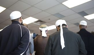 Representatives of Toronto's Islamic community attend a news conference in Toronto on April 22, 2013, as the Royal Canadian Mounted Police announce the arrest of two men accused of plotting a terror attack on a rail target. (Associated Press/The Canadian Press)