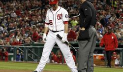 Washington Nationals' Adam LaRoche talks with home plate umpire Cory Blaser after a called third strike during the fourth inning of a baseball game against the St. Louis Cardinals at Nationals Park Tuesday, April 23, 2013, in Washington. (AP Photo/Alex Brandon)