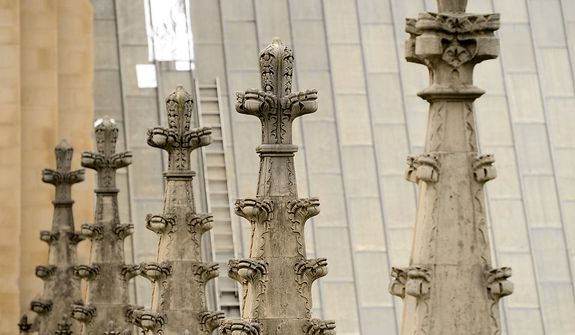 A section of patched roof is visible through a row of spires on the Washington National Cathedral, Washington, D.C., Monday, April 22, 2013. Sections of the roof were damaged from falling pieces of the cathedral during a 5.8 magnitude earthquake in August of 2011 (Andrew Harnik/The Washington Times)