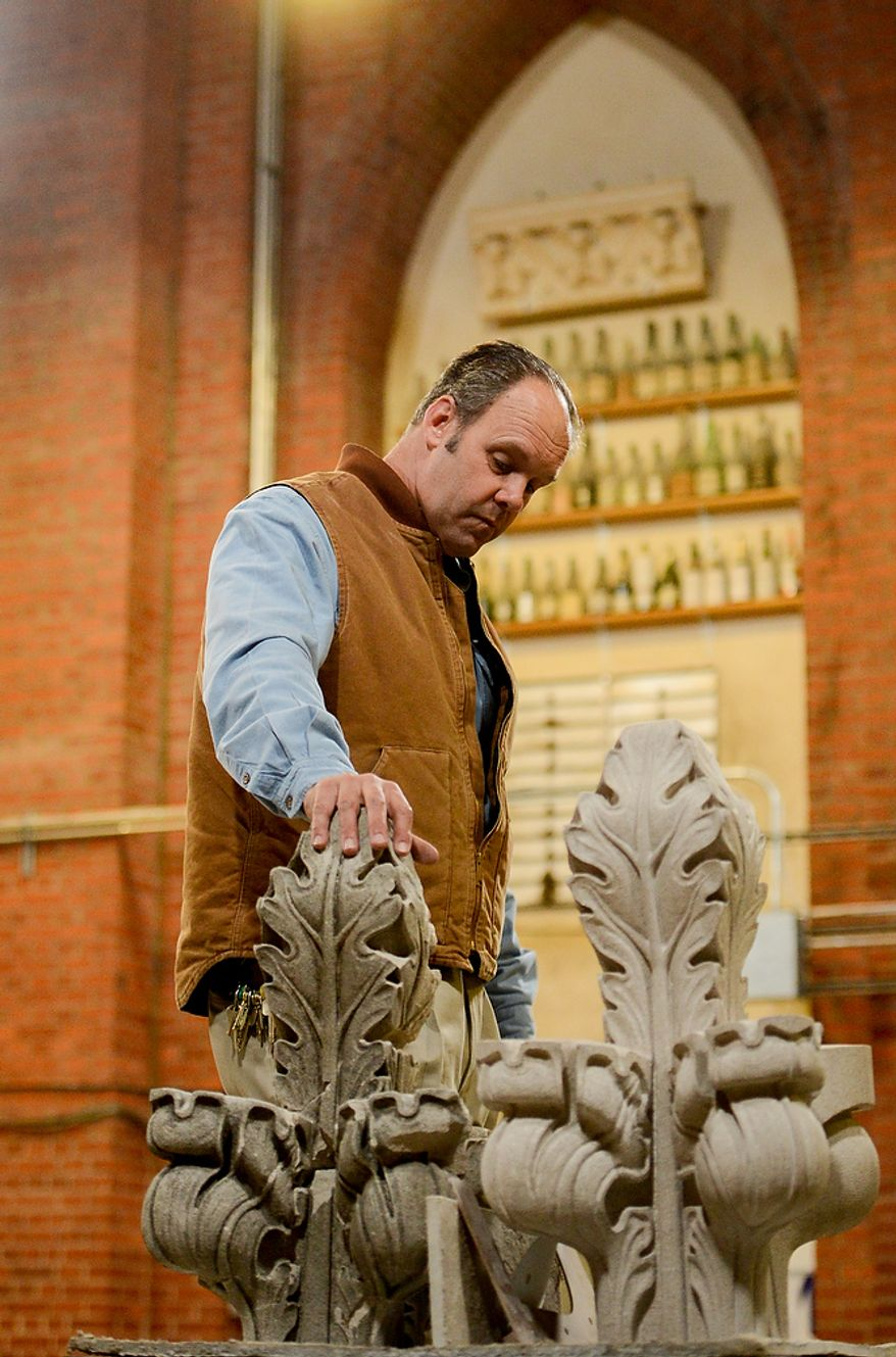 Head Stone Mason Joe Alonso shows off pieces of the original spires that broke off the Washington National Cathedral during a 5.8 magnitude earthquake in August of 2011 and their newly carved replacements which sit inside the base of the central tower before they are repositioned on the outside of the cathedral, Washington, D.C., Monday, April 22, 2013. (Andrew Harnik/The Washington Times)