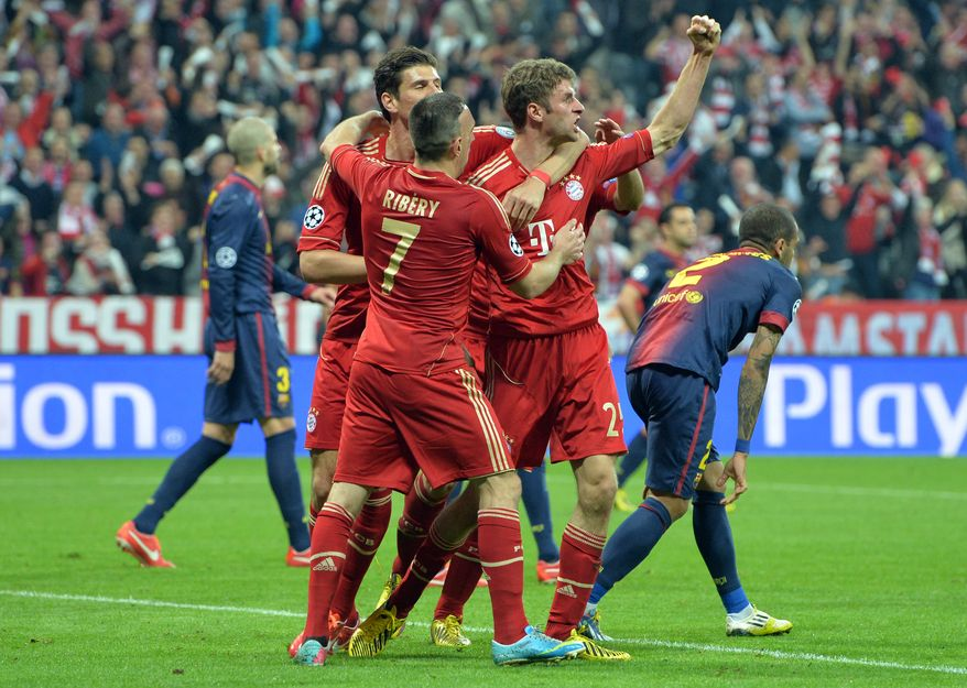 Bayern's Thomas Mueller, right, celebrates with teammates Mario Gomez and Franck Ribery after scoring during the Champions League semifinal first leg soccer match between Bayern Munich and FC Barcelona in Munich, Germany, Tuesday, April 23, 2013. (AP Photo/Kerstin Joensson)