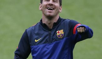 Barcelona's Lionel Messi laughs during a training session in Munich, southern Germany, on Monday, April 22, 2013. Bayern Munich will face FC Barcelona in a first leg Champions League semi final soccer match on Tuesday. (AP Photo/Matthias Schrader)