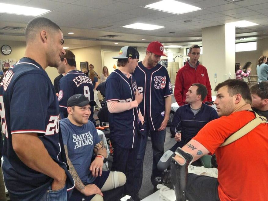 Washington Nationals players visit with military personnel rehabilitating at Walter Reed Medical Center. Photo/@nationals