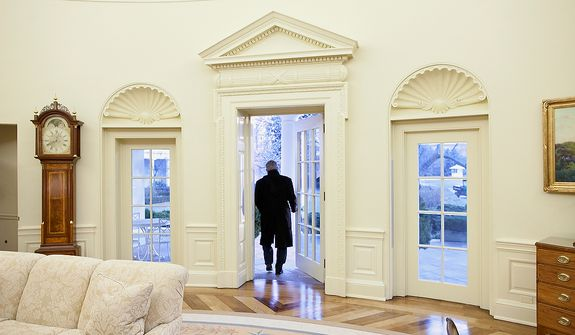 President George W. Bush leaves the Oval Office for the last time as president on his way to the Inauguration of Barack Obama. Photographs by Eric Draper from Front Row Seat: A Photographic Portrait of the Presidency of George W. Bush(Copyright © 2013). For more information visit www.utexaspress.com