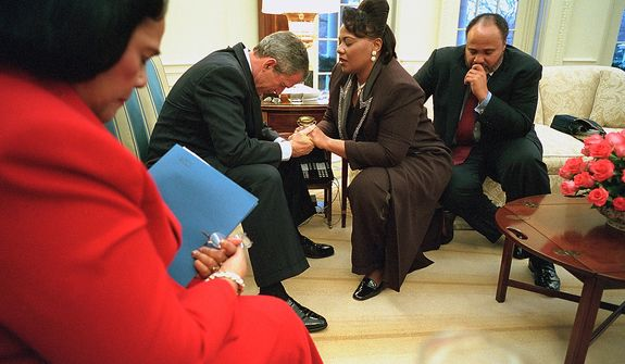 President George W. Bush joins in prayer with Coretta Scott King, left, Bernice King and Martin Luther King III during their visit to the Oval Office. Photographs by Eric Draper from Front Row Seat: A Photographic Portrait of the Presidency of George W. Bush(Copyright © 2013). For more information visit www.utexaspress.com