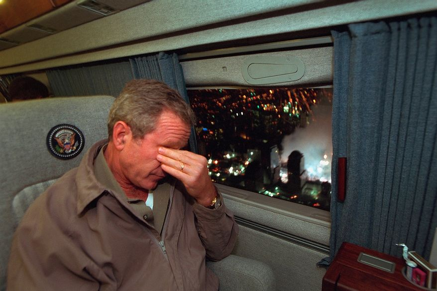 With smoke still billowing from the World Trade Center disaster site out the window, President George W. Bush departs New York City en route to Washington, D.C. aboard Marine One.  Photographs by Eric Draper from Front Row Seat: A Photographic Portrait of the Presidency of George W. Bush(Copyright © 2013). For more information visit www.utexaspress.com
