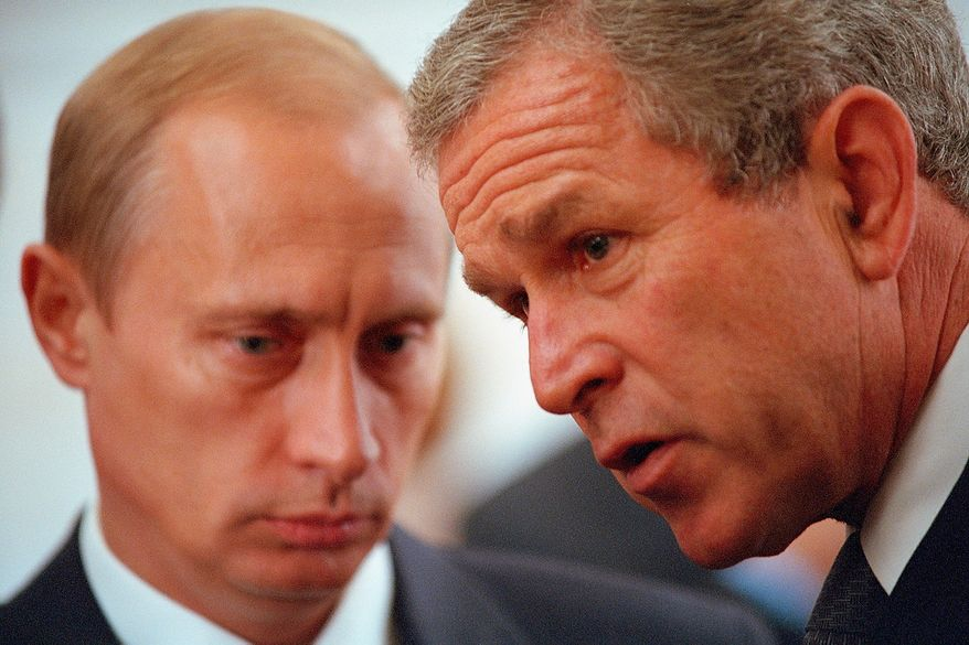 President George W. Bush meets with Russia's President Vladimir Putin Sunday, July 22, 2001, during a G8 reception at the Palazzo Ducale in Genoa, Italy. Photographs by Eric Draper from Front Row Seat: A Photographic Portrait of the Presidency of George W. Bush(Copyright © 2013). For more information visit www.utexaspress.com