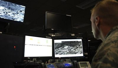**FILE** An Air Force analyst monitors combat operations in Afghanistan from the operations center for the 497th Intelligence, Surveillance and Reconnaissance Group at Langley Air Force Base in Hampton, Va. (Associated Press/U.S. Air Force)