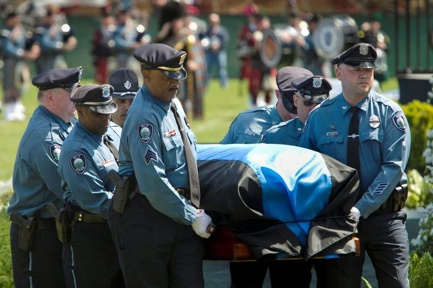 In a photo provided by Massachusetts Institute of Technology, MIT police pallbearers carry the casket of fallen MIT officer Sean Collier during a memorial service on the MIT campus in Cambridge, Mass., Wednesday, April 24, 2013. Collier was fatally shot on campus Thursday night, April 18, 2013. Authorities allege that the Boston Marathon bombing suspects were responsible. (AP Photo/Massachusetts Institute of Technology, Dominick Reuter)