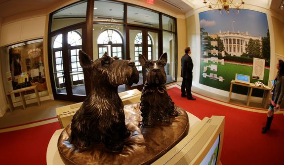 Busts of presidential pets Barney and Miss Beazley are also on display.