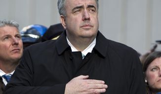 Edward Davis, Boston's police commissioner, salutes the American flag during a ceremony at the blast site on Boylston Street between Dartmouth and Exeter streets near the Boston Marathon finish line on Monday, April 22, 2013 in Boston. Federal investigators formally released the crime scene to the city in a brief ceremony at 5 p.m. (AP Photo/Robert F. Bukaty)