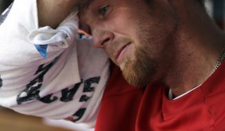 Washington Nationals starting pitcher Stephen Strasburg (37) sits in the dugout during a baseball game against the St. Louis Cardinals at Nationals Park Wednesday, April 24, 2013, in Washington. (AP Photo/Alex Brandon)