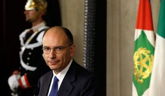 Italian Democratic Party lawmaker Enrico Letta makes a statement to the media after talks with Italian President Giorgio Napolitano in Rome's Quirinale Palace on Wednesday, April 24, 2013. Mr. Napolitano has appointed Mr. Letta, 46, as premier and asked him to try to form a government to end Italy's political paralysis and set the country back on the path of reform and economic growth. (AP Photo/Gregorio Borgia)