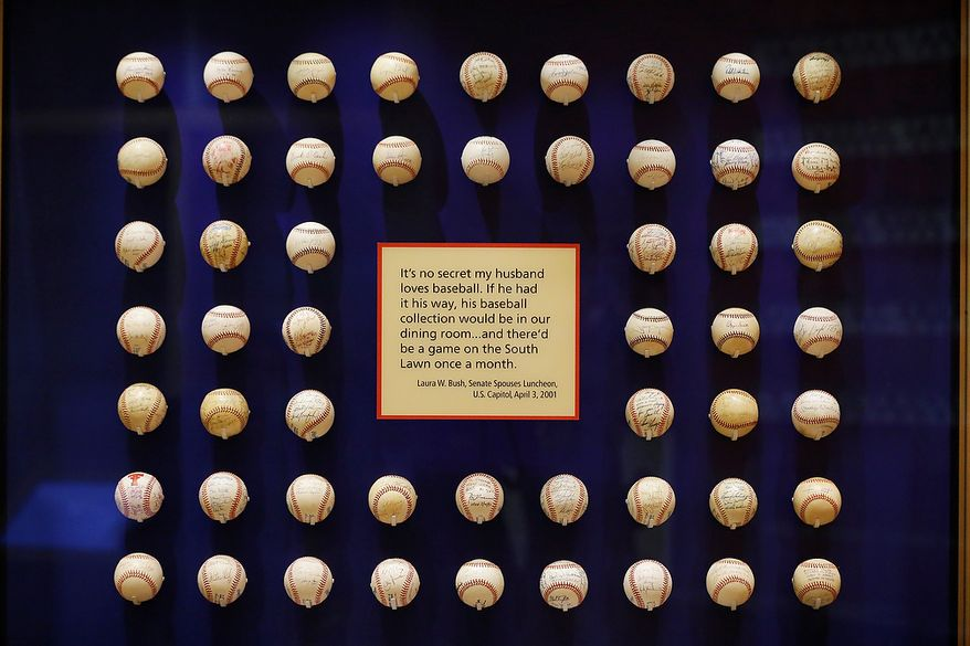Former President George W. Bush's baseball collection is seen on display during a tour of the George W. Bush Presidential Center Wednesday, April 24, 2013, in Dallas. More than 8,000 people are expected to attend the invitation-only dedication of the center, Thursday, April 25, which will house the presidential library and museum along with the 43rd presidentís policy institute. It opens to the public on May 1. (AP Photo/David J. Phillip)