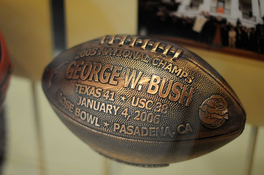 In this photo taken April 16, 2013, a football presented to president George W. Bush by the University of Texas Longhorns is seen in the museum area at the George W. Bush Presidential Library and Museum in Dallas.  The museum uses everything from news clips to interactive screens to artifacts to tell the story of Bushís eight years in office. The George W. Bush Presidential Center, which includes the library and museum along with 43rd presidentís policy institute, will be dedicated Thursday on the campus of Southern Methodist University in Dallas. (AP Photo/Benny Snyder)