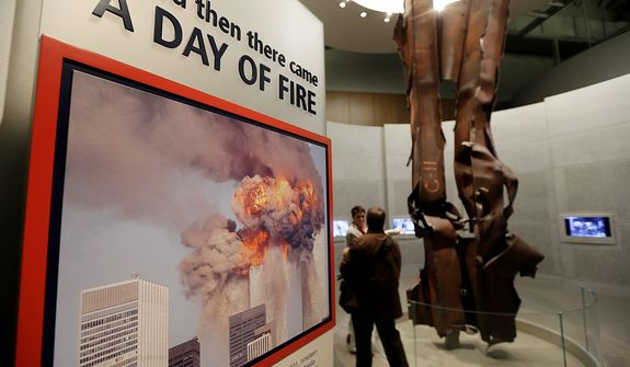 Beams damaged at New York's World Trade Center during the terrorist attacks on Sept. 11, 2001 are seen on display during a tour of the George W. Bush Presidential Center Wednesday, April 24, 2013, in Dallas. (AP Photo/David J. Phillip)