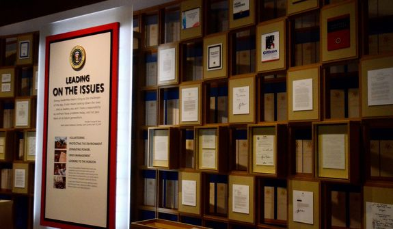 In this photo taken April 16, 2013, a variety of different documents from the president George W. Bush administration are on display in the museum area at the George W. Bush Presidential Library and Museum in Dallas. The museum uses everything from news clips to interactive screens to artifacts to tell the story of Bushís eight years in office. The George W. Bush Presidential Center, which includes the library and museum along with 43rd presidentís policy institute, will be dedicated Thursday on the campus of Southern Methodist University in Dallas. (AP Photo/Benny Snyder)