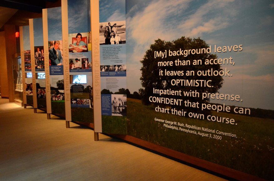 In this photo taken April 16, 2013, a quote from the 2000 Republican National Convention by George W. Bush greets visitors to the museum exhibit section of the George W. Bush Presidential Library and Museum in Dallas. The museum uses everything from news clips to interactive screens to artifacts to tell the story of Bushís eight years in office. The George W. Bush Presidential Center, which includes the library and museum along with 43rd presidentís policy institute, will be dedicated Thursday on the campus of Southern Methodist University in Dallas.  (AP Photo/Benny Snyder)