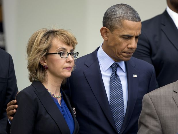 President Obama puts his arm around former Rep. Gabrielle Giffords, Arizona Democrat, before he speaks in the Rose Garden at the White House in Washington on April 17, 2013, about measures to reduce gun violence. (Associated Press) **FILE**