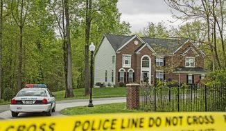 Police tape blocks off the driveway of the Upper Marlboro home of D.C. police Detective Joseph B. Newell, who was found fatally shot Monday. His stepson, Antwan Rayvon James, is accused of killing him. (Andrew S Geraci/The Washington Times)
