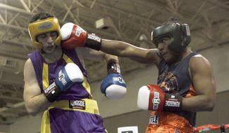 ** FILE ** In this May 4, 2009, file photo, Tamerlan Tsarnaev, left, fights Lamar Fenner of Chicago, in the 201 weight class, during the 2009 Golden Gloves National Boxing Tournament at the Salt Palace, Monday, May 4, 2009. Tsarnaev was identified as a suspect in the Boston Marathon bombings. (AP Photo/The Salt Lake Tribune, Rick Egan)