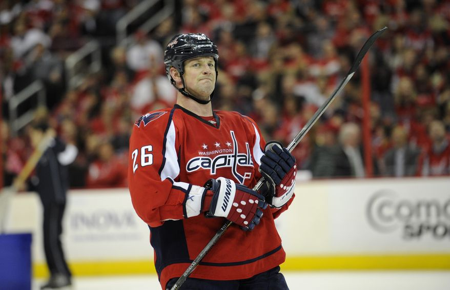 Washington Capitals center Matt Hendricks (26) looks on during the second period of an NHL hockey game against the Winnipeg Jets, Tuesday, April 23, 2013, in Washington. (AP Photo/Nick Wass)