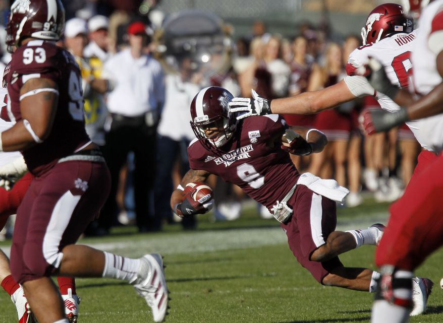 Mississippi State defensive back Darius Slay (9) loses his balance as he runs back a fourth quarter interception for 15-yards against Arkansas in an NCAA college football game in Starkville, Miss., Saturday, Nov. 17, 2012. Mississippi State won 45-14. (AP Photo/Rogelio V. Solis)