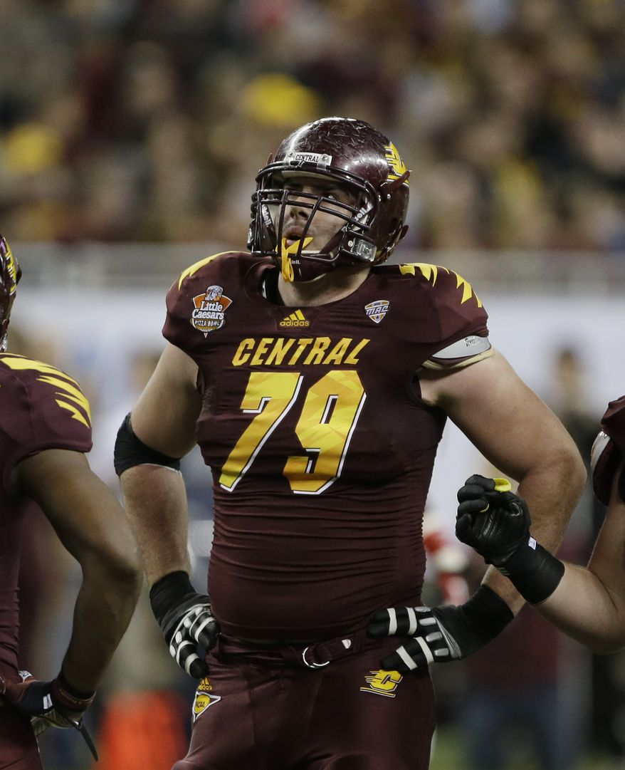 Central Michigan offensive linesman Eric Fisher (79) blocks Western Kentucky is seen during the first quarter of the Little Caesars Pizza Bowl NCAA college football game against Western Kentucky at Ford Field in Detroit, Wednesday, Dec. 26, 2012. (AP Photo/Carlos Osorio)