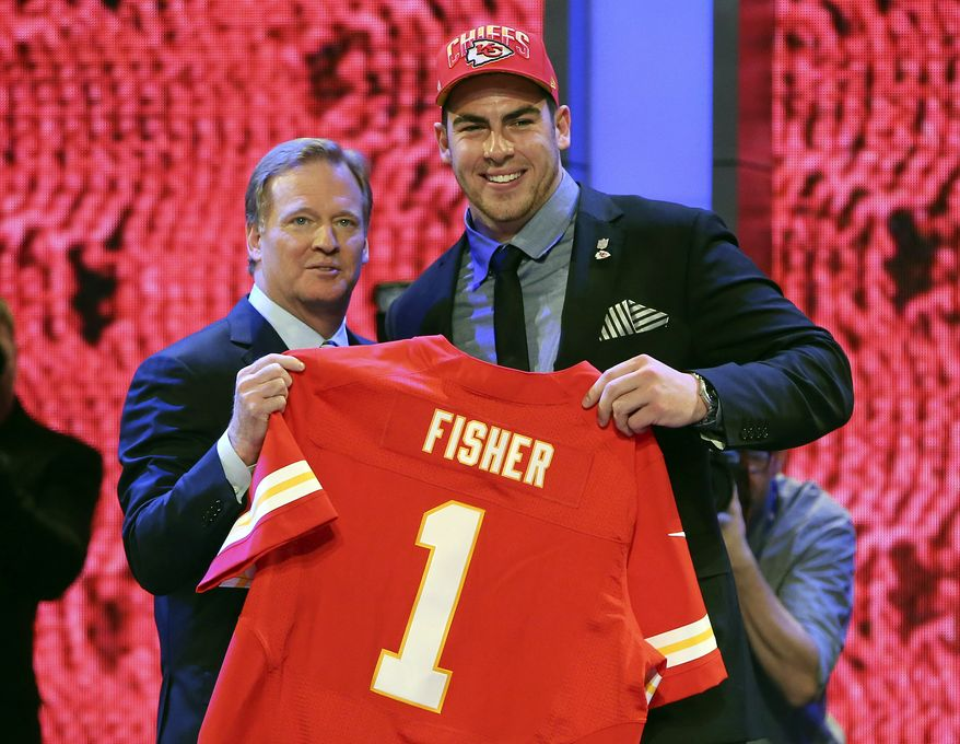 Tackle Eric Fisher from Central Michigan stands with NFL commissioner Roger Goodell after being selected first overall by the Kansas City Chiefs in the first round of the NFL football draft, Thursday, April 25, 2013 at Radio City Music Hall in New York. (AP Photo/Mary Altaffer)