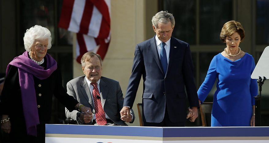 From left, former first lady Barbara Bush, President George H.W. Bush, former president George W. Bush and former first lady Laura Bush holds hands during the invocationduring the dedication of the George W. Bush Presidential Center Thursday, April 25, 2013, in Dallas. (AP Photo/David J. Phillip)