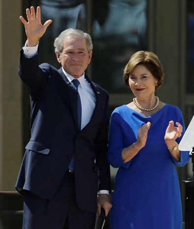 Former president George W. Bush waves with  his wife Laura speech during the dedication of the George W. Bush Presidential Center Thursday, April 25, 2013, in Dallas. (AP Photo/David J. Phillip)