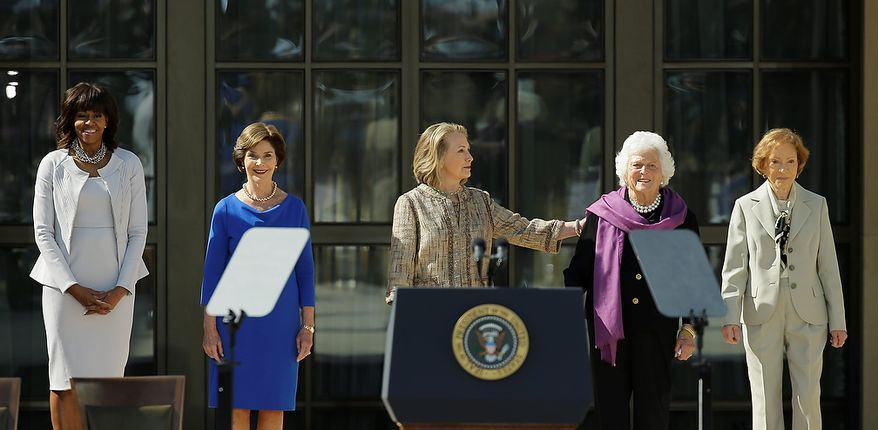 From left, First Lady Michelle Obama, former first lady Laura Bush, former first lady Hillary Clinton, former first lady Barbara Bush and former first lady Rosalynn Carter arrive for the dedication of the George W. Bush Presidential Center Thursday, April 25, 2013, in Dallas. (AP Photo/David J. Phillip)