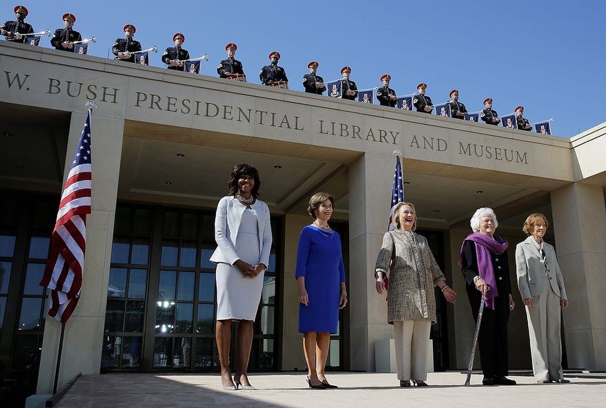 From left, First Lady Michelle Obama, former first lady Laura Bush, former first lady Hillary Clinton, former first lady Barbara Bush, former first lady Rosalynn Carter arrive for the dedication of the George W. Bush Presidential Center Thursday, April 25, 2013, in Dallas. (AP Photo/David J. Phillip)