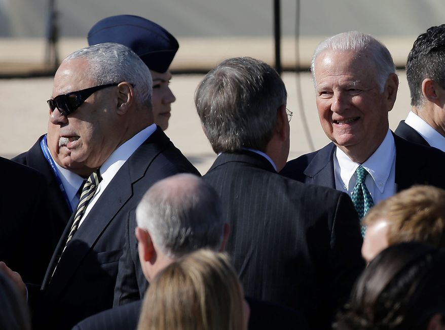 Former Secretary of State and retired four-star general Colin Powell, left, and former Secretary of State James Baker arrive for the dedication of the George W. Bush Presidential Center Thursday, April 25, 2013, in Dallas. (AP Photo/David J. Phillip)