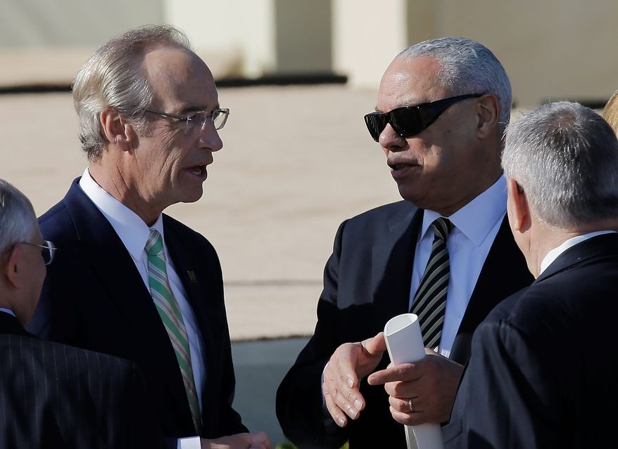 Former Secretary of State and retired four-star general Colin Powell, right, arrives for the dedication of the George W. Bush Presidential Center Thursday, April 25, 2013, in Dallas. (AP Photo/David J. Phillip)