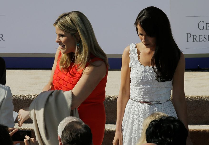 Jenna Bush Hager, left and her sister Barbara arrive for the dedication of the George W. Bush Presidential Center Thursday, April 25, 2013, in Dallas. (AP Photo/David J. Phillip)