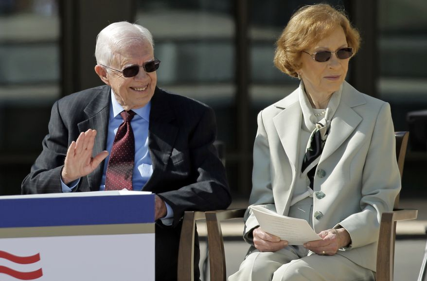 Former president Jimmy Carter and his wife, former first lady Rosalynn Carter arrive for the dedication of the George W. Bush Presidential Center, Thursday, April 25, 2013, in Dallas. (AP Photo/David J. Phillip)