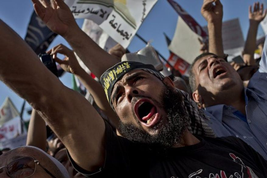 ** FILE ** Egyptian Muslims shout Islamic slogans during a rally in Tahrir Square in Cairo, Egypt, Friday, Nov. 9, 2012.