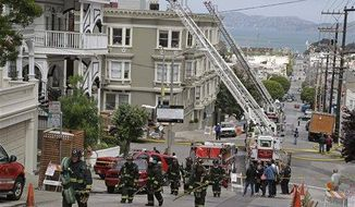 A group of San Francisco firemen make their way up a hill after a fire was contained at a multi-unit Pacific Heights building in San Francisco, April 24, 2013. Some San Francisco firefighters are raking in six-figure overtime paychecks because of staffing shortages that have department managers scheduling numerous extra shifts, a newspaper reported.