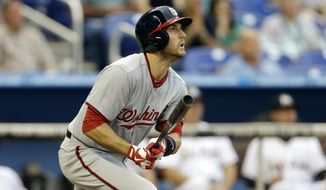 Washington Nationals' Steve Lombardozzi flies out during the first inning of a baseball game against the Miami Marlins in Miami, Wednesday, April 17, 2013. (AP Photo/J Pat Carter)