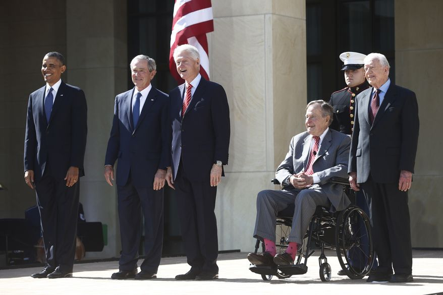 President Barack Obama stands with former presidents George W. Bush, Bill Clinton, George H.W. Bush, and Jimmy Carter at the dedication of the George W. Bush presidential library on the campus of Southern Methodist University in Dallas, Thursday, April 25, 2013. (AP Photo/Charles Dharapak)