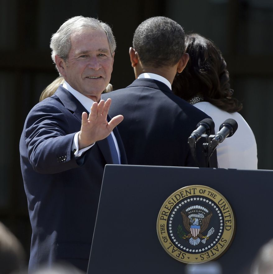 ** FILE ** Former President George W. Bush turns and waves as he follows President Obama and first lady Michelle Obama as they leave after the dedication of the George W. Bush Presidential Center, Thursday, April 25, 2013, in Dallas. (AP Photo/LM Otero)